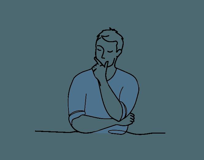 Zamyślony, młody mężczyzna w zielonym swetrze